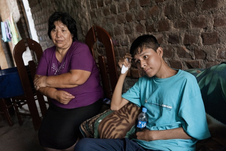 <p>In Lima, Steven Castro Espinoza, 19, talks about taking his TB medicine as his mother, Eva Davita Espinoza Gomez, listens. Steven has multi-drug-resistant TB, as does one of his brothers. But Steven is taking medicine while his brother refuses, causing much fear in the house of the disease passing to others.</p>