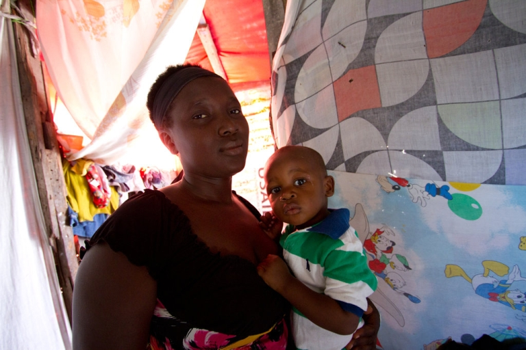 <p>Islande Vilmeus, 31, lives in a shack with her son Abraham, 2, and three other children since her home was destroyed in the earthquake two years ago.</p>