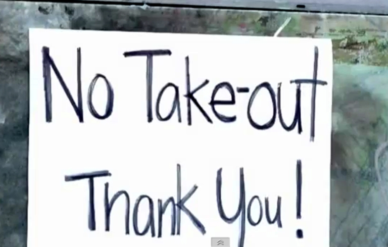 <p>A still image taken from Associated Press video shows a sign at the Sam Wo restaurant bluntly telling customers they may eat in only.</p>
