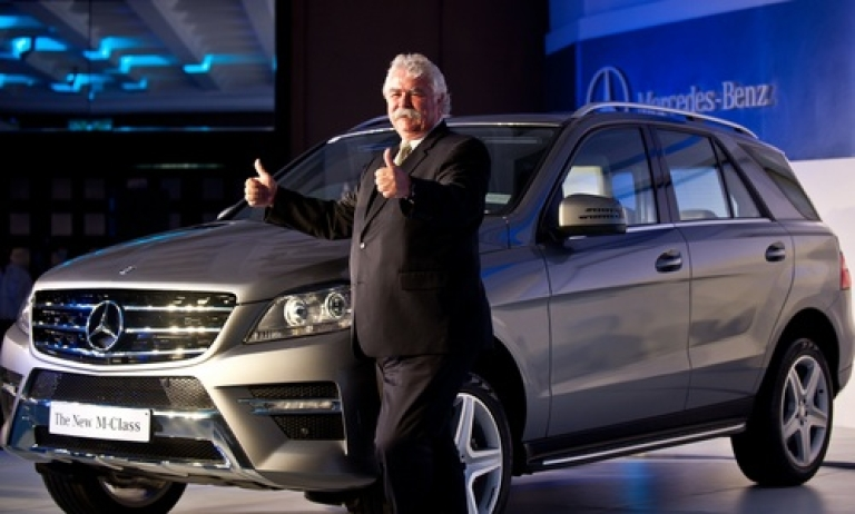 <p>Managing Director and CEO , Mercedes-Benz India Peter Honegg gestures while posing with the new edition Mercedes-Benz M-class SUV car in New Delhi on May 15, 2012.  Presumably, now he's doing something else with his thumbs.</p>