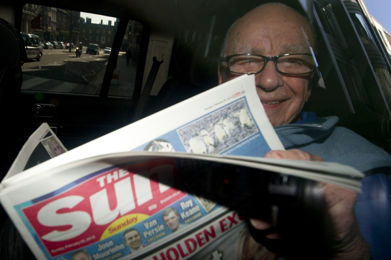 <p>News Corporation Chief Rupert Murdoch holds up a copy of the newly launched 'The Sun on Sunday' newspaper as he leaves his London home on February 26, 2012. Rupert Murdoch will be called in to testify by the Leveson inquiry into media ethics in late April or early May, sources say.</p>