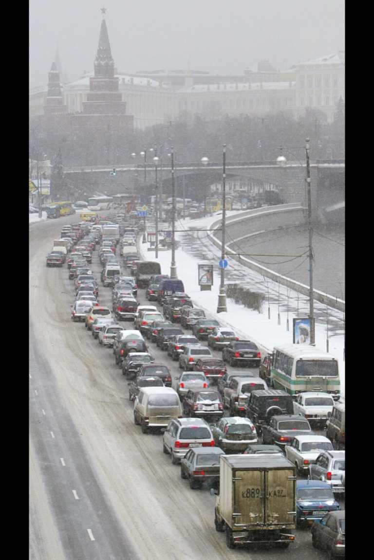 <p>In this 2005 file photo, a traffic jam is seen on the bank of Moskva River with the Kremlin on the background, as a heavy snowfall hit the Russian capital. In December 2012, a 125-mile traffic jam left Russian drivers stranded and freezing over the weekend on a highway that connects Moscow and St. Petersburg.</p>