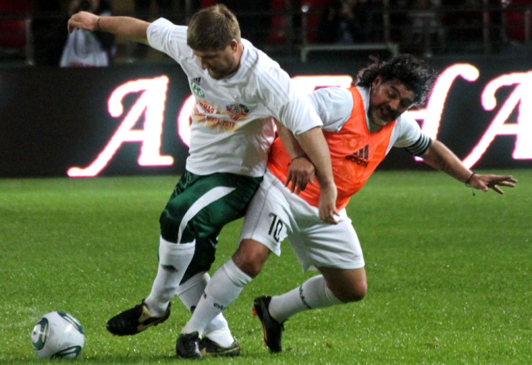 <p>Soccer legend Diego Maradona (right) fights Chechnya's leader Ramzan Kadyrov for the ball during a match pitting Maradona's all-star squad of former internationals against the local officials' team in Grozny, on May 11, 2011.</p>