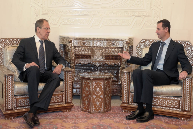 <p>Russia's Foreign Minister Sergei Lavrov has denied any plans to offer asylum to Syrian President Bashar al-Assad after his government falls.<br /> Assad (R) speaks with Lavrov during their  meeting at the presidential palace in Damascus, on February 7, 2012.</p>