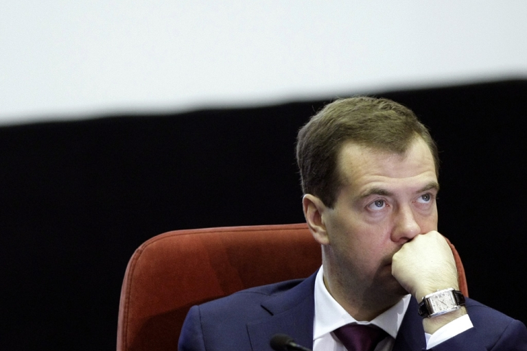 <p>Russian President Dmitry Medvedev looks on during a meeting with top police officials in Moscow, on March 22, 2011. Medvedev and Prime Minister Vladimir Putin split on their opinions over air strikes in Libya.</p>