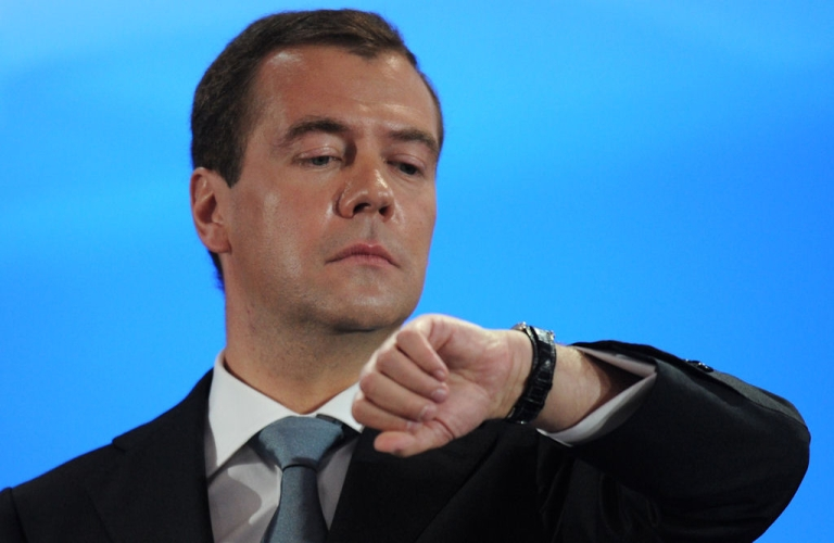 <p>Russian President Dmitry Medvedev checks his watch during a news conference on May 18, 2011 at the Skolkovo center outside Moscow.</p>