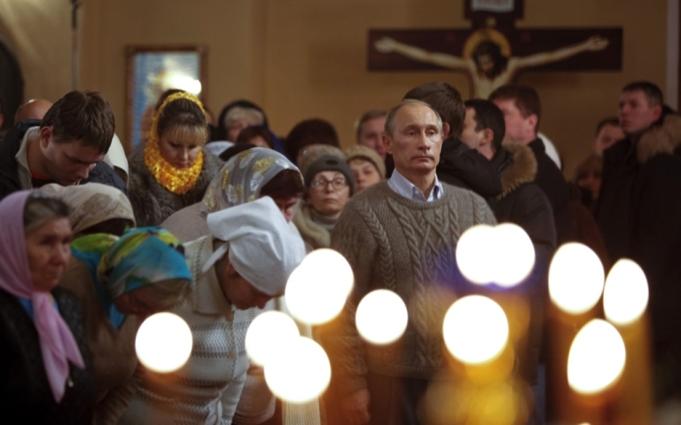 <p>Russian Prime Minister Vladimir Putin (R) attends an Orthodox Christmas service in the XIX century church of the Protecting Veil of the Mother of God in Turginovo, about 160 kilometers northwest of Moscow on Jan. 7, 2011. Thirteen days after Western Christmas, on Jan. 7, the Russian Orthodox Church celebrates its Christmas, in accordance with the old Julian calendar.</p>