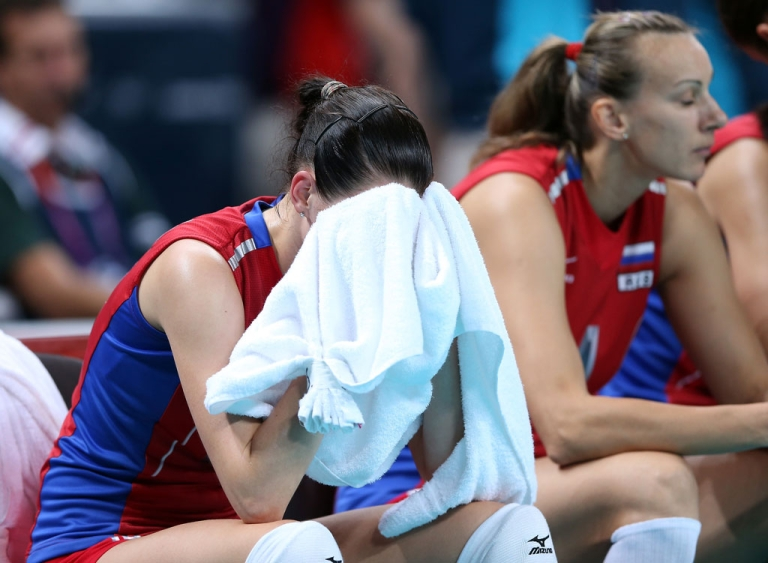 <p>Evgeniya Startseva #13 of Russia reacts after the loss to Brazil during Women's Volleyball quarterfinals on Day 11 of the London 2012 Olympic Games at Earls Court on August 7, 2012 in London, England.</p>