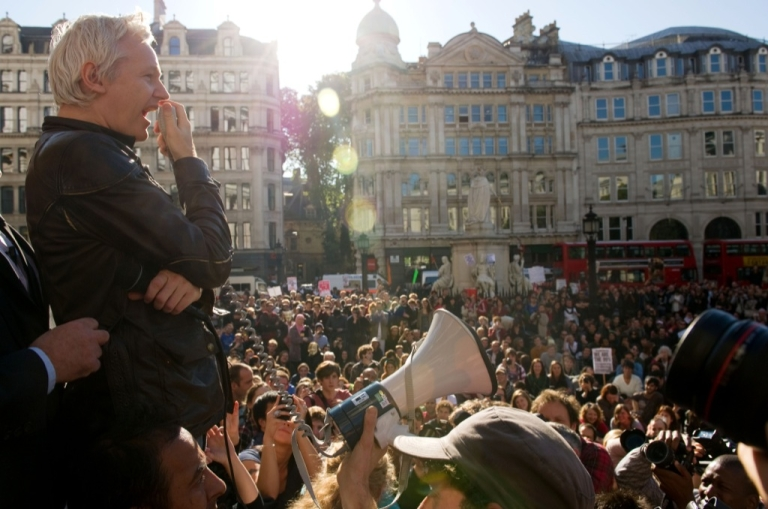 <p>Wikileaks founder Julian Assange speaks to demonstrators from the steps of Saint Paul's Cathedral in central London on Oct. 15, 2011. Around 800 people rallied in London's financial heart amid a heavy police presence as part of world protests against corporate greed and budget cutbacks. Inspired by the Occupy Wall Street movement and Spain's 'Indignants', people began taking to the streets across the world, targeting 951 cities in 82 countries.</p>