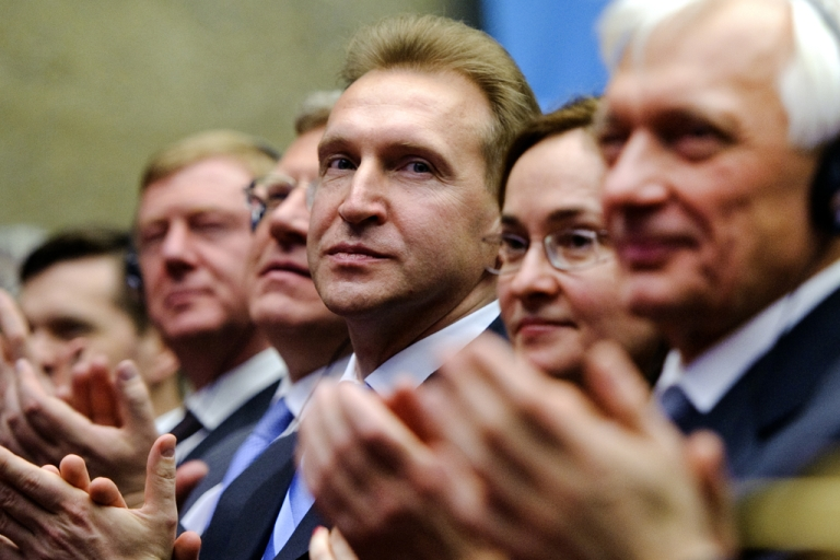 <p>First Deputy Prime Minister Igor Shuvalov of Russia applauds after the World Trade Organization gave its official approval for Russia's membership in the trade body.</p>
