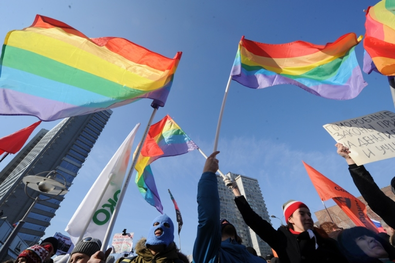<p>Russian gay rights activists take part in a rally against Vladimir Putin in the central Arbat area in Moscow, on March 10, 2012.</p>