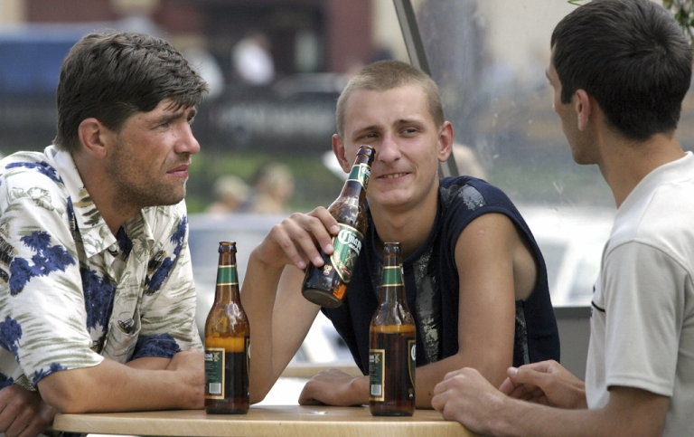 <p>Three Russian men drink a beer in the open air snack-bar in Moscow. Russian President Dmitry Medvedev has signed a bill that officially classifies beer as alcoholic.</p>