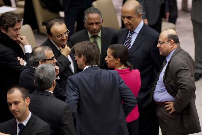<p>US Ambassador to the United Nations Susan Rice talks to other diplomats before a vote on a resolution on Syria in the United Nations Security Council during a meeting on Syria February 4, 2012 at the United Nations in New York.</p>
