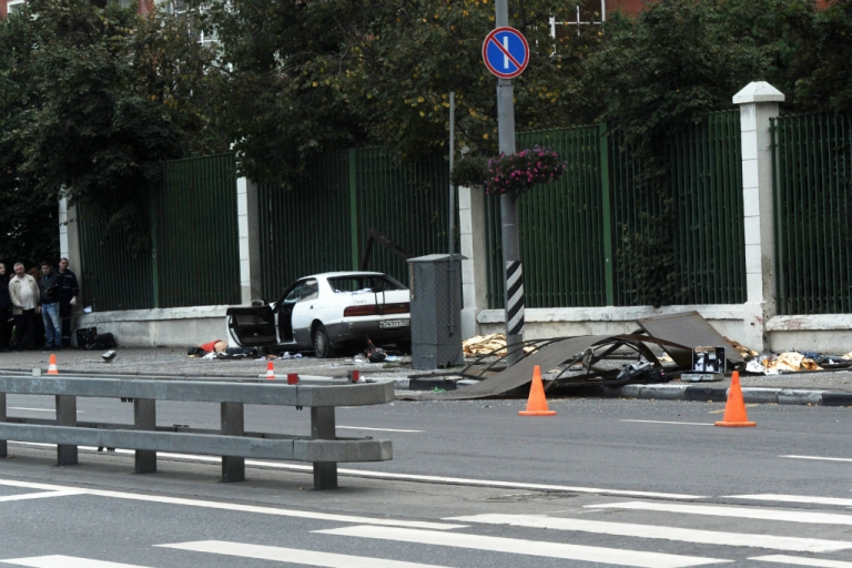 <p>Victims lie under emergency blankets on a street in Moscow on September 22, 2012. A drunken man racing at 125 miles per hour through Moscow traffic killed seven teens after slamming into a bus stop and dragging it a part of the way down the block.</p>
