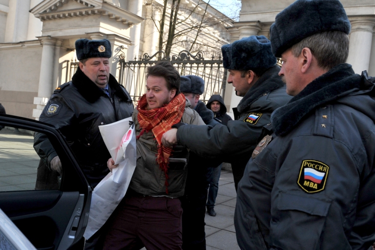 <p>Police officers detain a gay rights activist in St. Petersburg, Russia, on April 5, 2012.</p>
