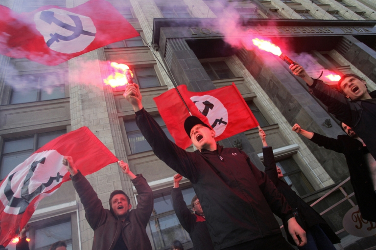<p>Members of the ultra-left Russian National Bolshevik party (NBP) shouting slogans during an unsactioned protest outside the Russian Parliament building in Moscow. The NBP, headed by opposition favorite Eduard Limonov, has been placed on a Russian terrorist watch list.</p>