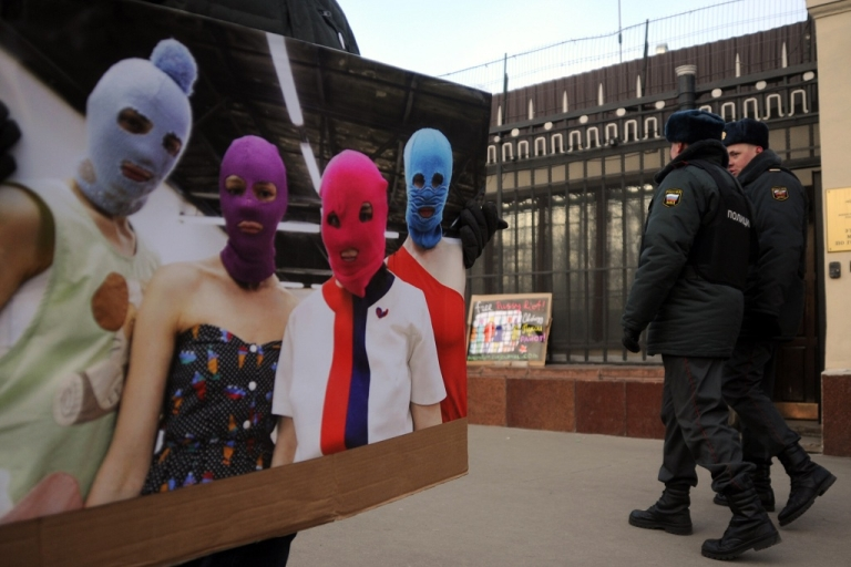 <p>A supporter of the female Russian punk band Pussy Riot picket pickets the police headquarters in Moscow on Mar. 8, 2012, shortly after three members of the group were arrested for allegedly storming the altar of a Moscow church and performing a protest song.</p>