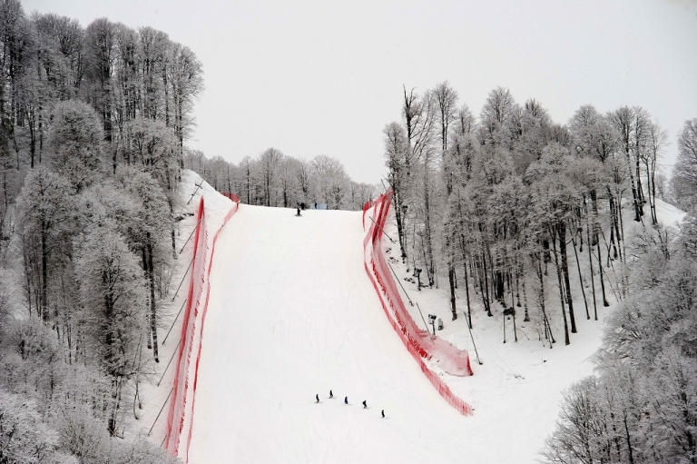 <p>Race technicians ski down a hill at the Rosa Khutor Mountain Resort in Krasnaya Polyana near Sochi on Feb. 18, 2012. Russia will host the 2014 Winter Olympic Games there.</p>
