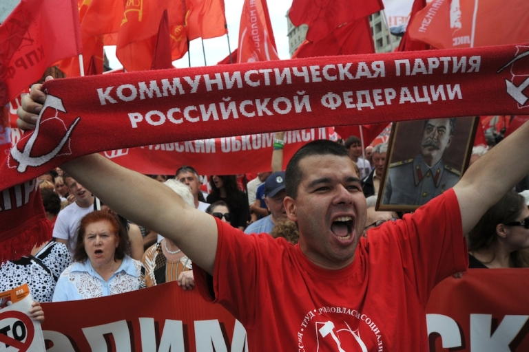 <p>Communist Party supporters rally against Russia's impending membership of the World Trade Organization just outside the Red Square in Moscow, on July 3, 2012.</p>