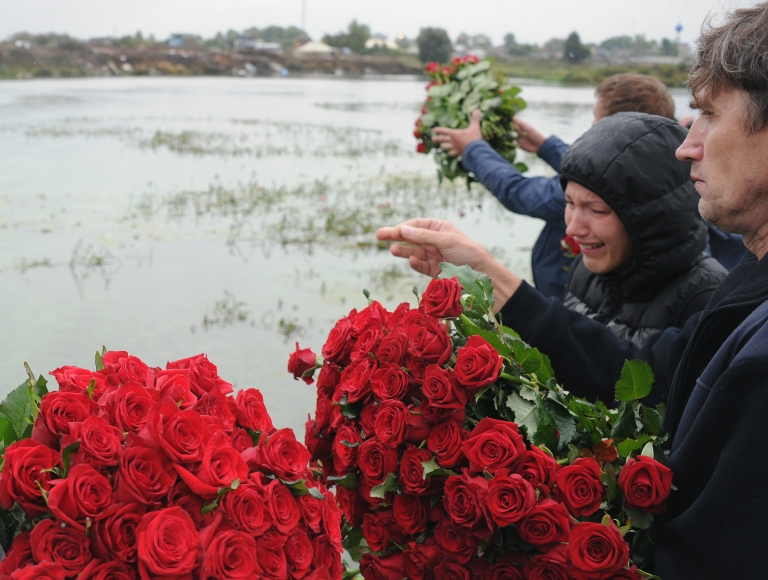 <p>People lay flowers at the site of a plane crash that killed the Lokomotiv Yaroslavl hockey team in 2011. The team was traveling to their first match of the KHL (Kontinental Hockey League) season when their plane crashed on takeoff.</p>