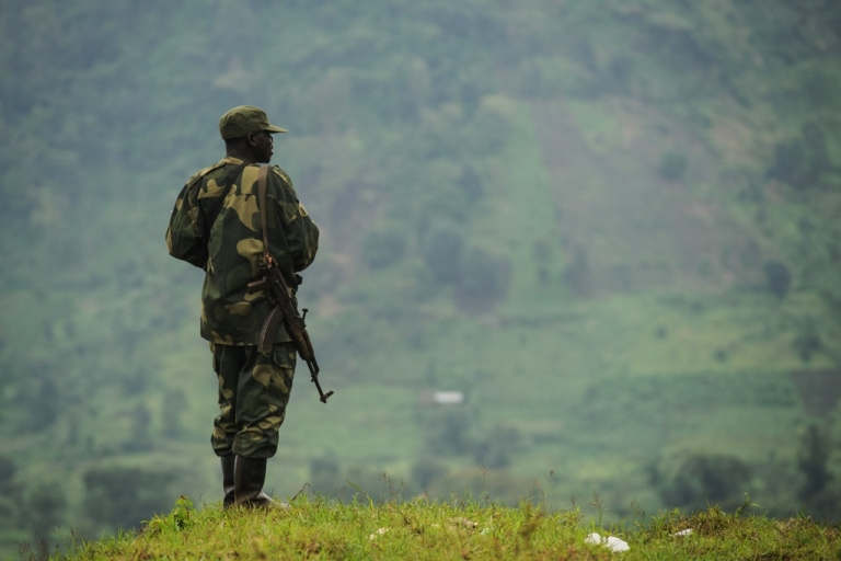 <p>A soldier from the Armed Forces of the Democratic Republic of the Congo (FARDC) on the lookout for M23 rebels at an army outpost between the village of Kachiru and Mbuzi hill — an M23 rebel position — in North Kivu, eastern Congo on May 24, 2012. A UN report charges that Rwanda has supported the M23 rebels, but the Rwandan government denies the allegation.</p>