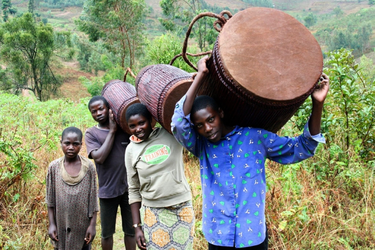 <p>Following centuries of tradition, Denis Kagaba has crafted handmade drums from his rural home in Rwanda. At 15, his son Jean-Paul (right) is a keen apprentice.</p>