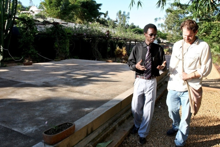 <p>Rwanda Genocide Memorial Center director Honore Gatera explains the center's exhibits to Charlie Annenberg Weingarten, founder of Explore.org and director of the movie, Raindrops Over Rwanda.</p>
