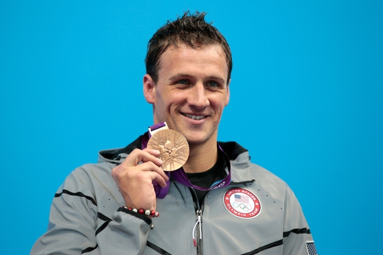<p>Silver medallist Ryan Lochte poses on the podium during the medal ceremony for the Men's 200m Individual Medley on August 2, 2012, after losing to Michael Phelps (again).</p>