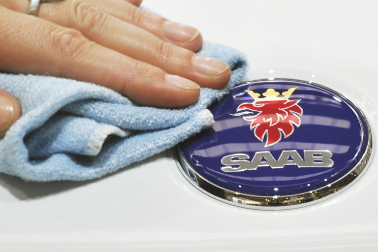 <p>A trade fair employee polishes the logo of a Saab car during the 63rd International Motor Show (IAA) in the central German city of Frankfurt on Sept. 16, 2009.</p>