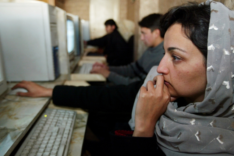 <p>A woman uses a computer at an Internet cafe in Afghanistan.</p>