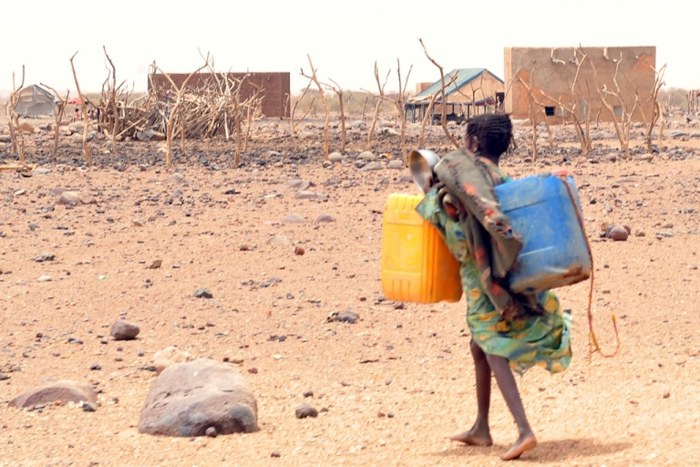 <p>A girl carries cans to fill with water in southeastern Mauritania, on May 4, 2012. The food crisis across West Africa's Sahel region puts millions at risk of hunger, according to the UN.</p>
