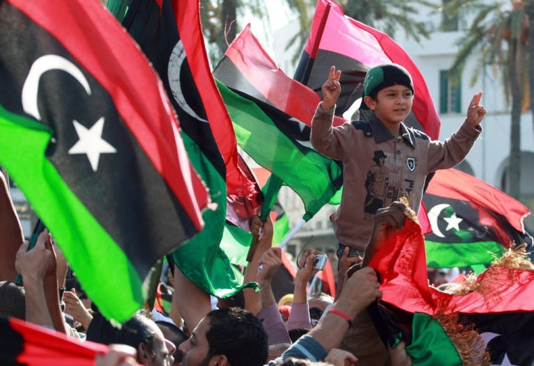 <p>Libyans celebrate the news of Saif al-Islam Gaddafi's capture. There is strong public demand for him to face trial in Libya.</p>