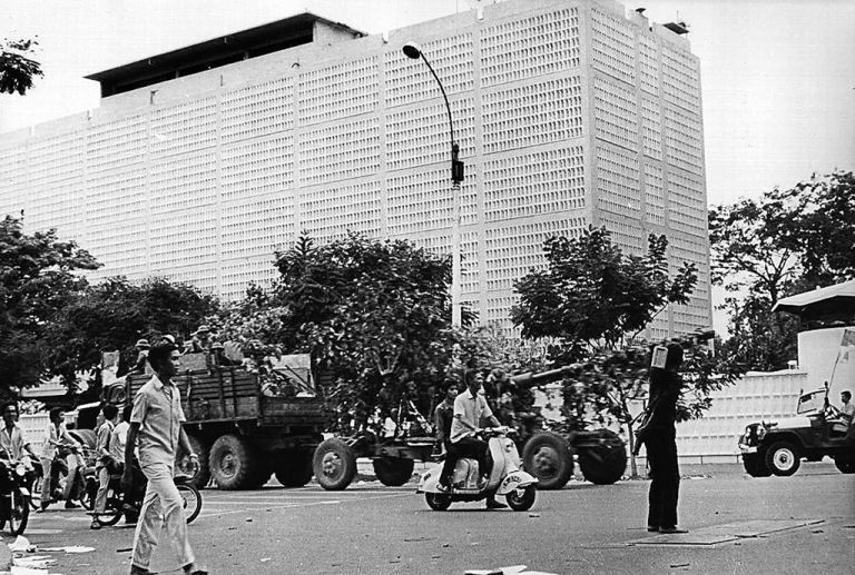 <p>A 30 April 1975 photo shows a North Vietnamese military truck pulling a canon pass the abandoned US Embassy in Saigon after the city fell into the hands of communist troops on the same day, marking the end of the Vietnam War.</p>