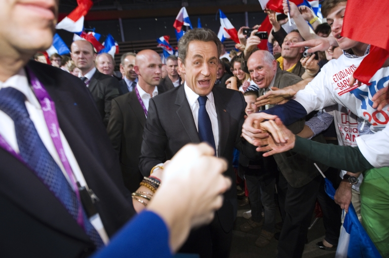 <p>Nicolas Sarkozy greets party loyalists as he arrives Saturday for a campaign event in Lyon, eastern France.</p>