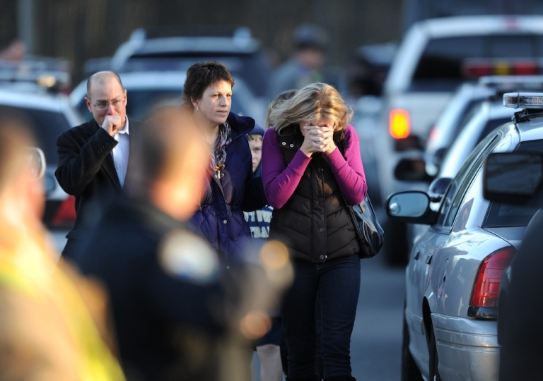 <p>Residents grieve following a shooting December 14, 2012 at Sandy Hook Elementary School on December 14, 2012 in Newtown, Connecticut.</p>