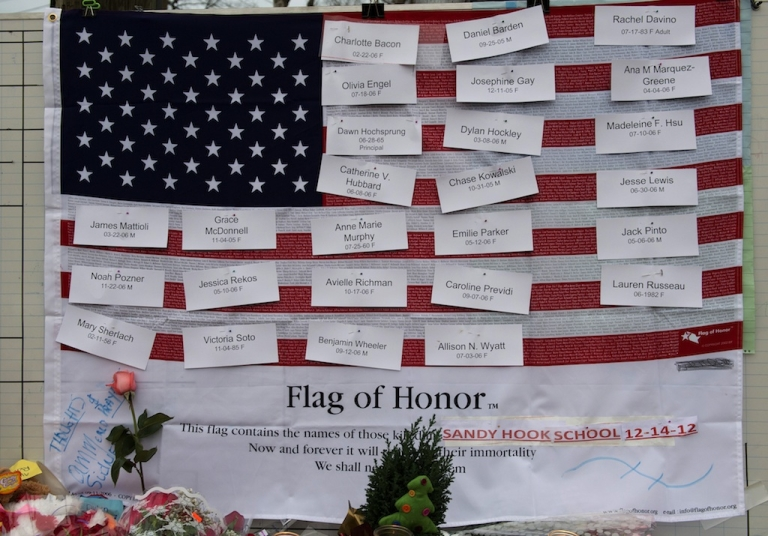 <p>Names of victims are displayed on a flag in the business area December 16, 2012 in Newtown, Connecticut.</p>