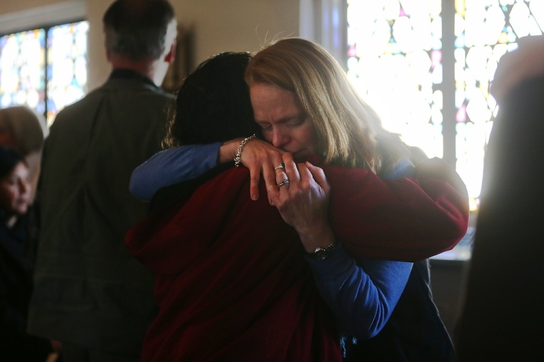 <p>People embrace at a prayer service to reflect on the violence at Sandy Hook Elementary School at St. John Episcopal Church on December 15, 2012 in Newtown, Connecticut.</p>