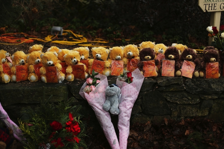 <p>Teddy bears and flowers, in memory of those killed, are left at a memorial down the street from the Sandy Hook School December 16, 2012 in Newtown, Connecticut.</p>