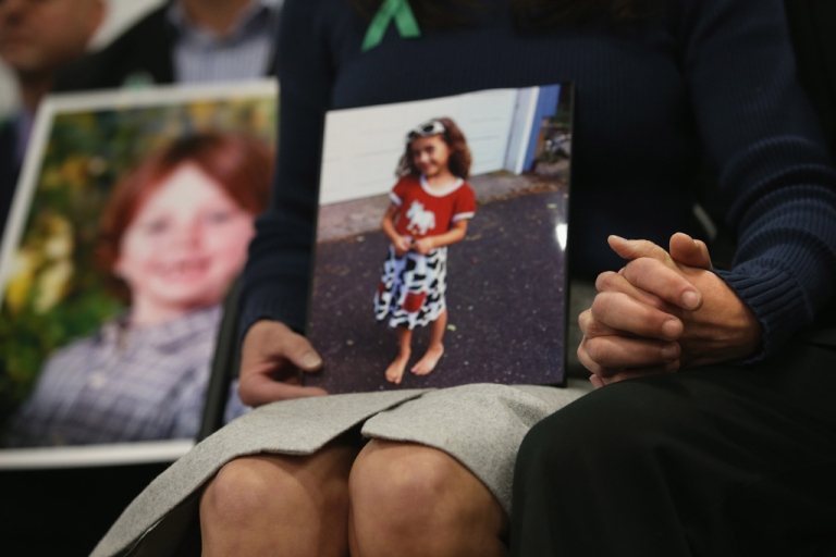 <p>Parents of Sandy Hook Elementary massacre victims hold hands during a press conference on the one month anniversary of the Newtown elementary school massacre on January 14, 2013 in Newtown, Connecticut. Eleven families of Sandy Hook massacre victims came to the event one month after the shooting to give their support to Sandy Hook Promise, a new non-profit with the goal of preventing such tragedies in the future.</p>