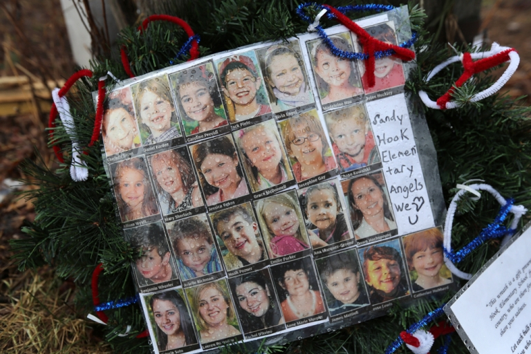 <p>Photos of Sandy Hook Elementary School massacre victims sits at a small memorial near the school on January 14, 2013 in Newtown, Connecticut. The town marked a month anniversay since the massacre of 26 children and adults at the school, the second-worst such shooting in U.S. history.</p>