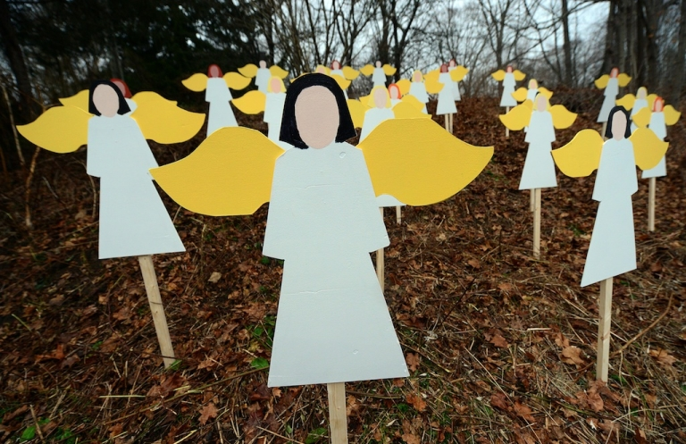 <p>Twenty seven angel wood cut-outs are set up on hillside in memory to the victims of an elementary school shooting in Newtown, Connecticut, December 16, 2012.</p>