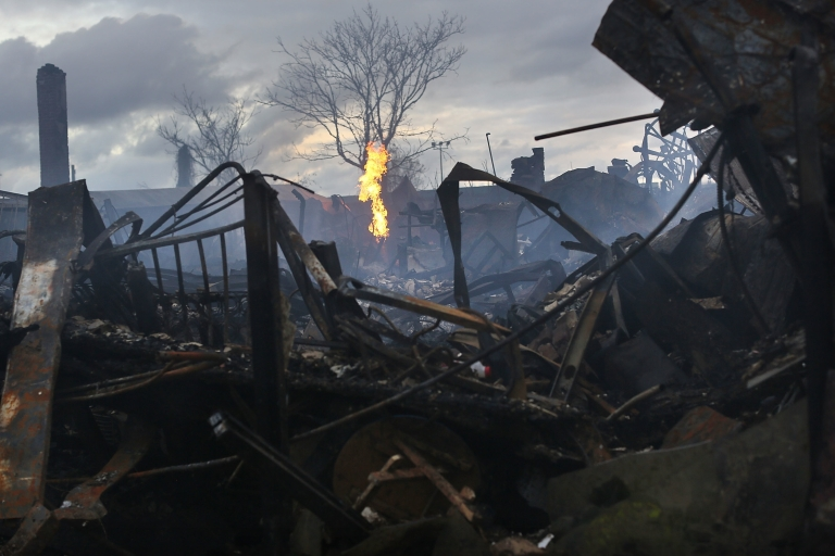 <p>Homes and businesses burned down in the Rockaway, Queens during superstorm Sandy. Can New York City and other areas hit hard by the storm recover in time for the Nov. 6 election?</p>