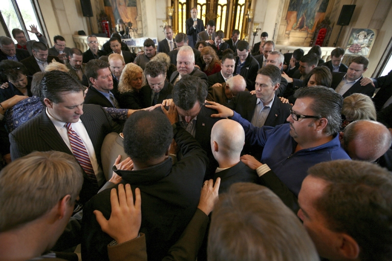 <p>Supporters pray over Republican presidential candidate Rick Santorum during a campaign stop at the Bella Donna Chapel today in McKinney, Texas.</p>
