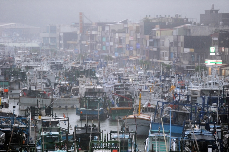 <p>Fishing boats are moored in a shelter at the Nanfangao harbor in eastern Ilan county, as typhoon Saola approches the island's east coast on August 2, 2012. Typhoon Saola reached Taiwan, causing nearly the entire island to close down and bringing torrential rains that could linger until next week, officials said.</p>