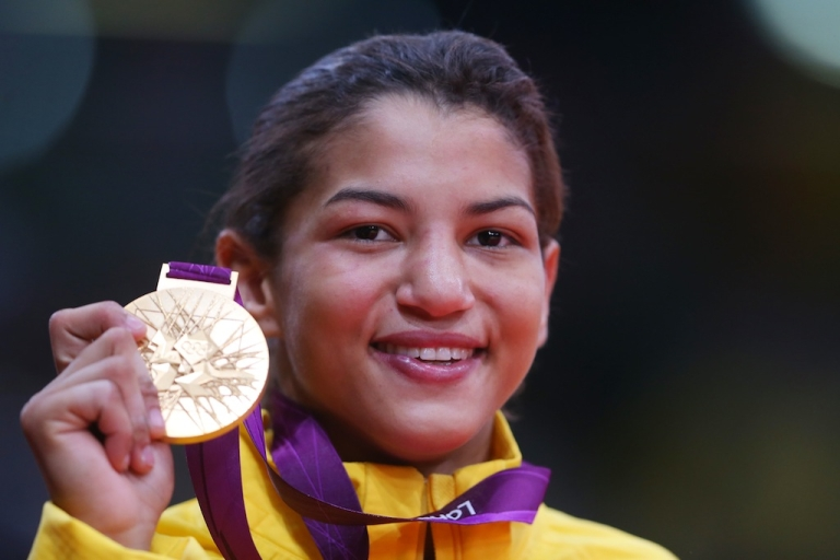 <p>Sarah Menezes of Brazil celebrates winning the gold medal in the women's 48kg judo category at the London 2012 Olympic Games on July 28, 2012 in London, England.</p>
