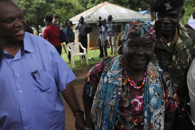 <p>Sarah Obama, step-grandmother to President Barack Obama, leaves a press conference at her home on November 6, 2012 in the village of Kogelo, Kenya, where Obama's father was born.</p>
