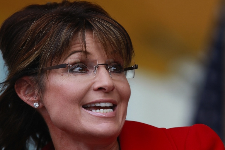 <p>Former Alaska governor Sarah Palin speaks during a Tea Party Express rally on Sept. 5, 2011, in Manchester, New Hampshire.</p>