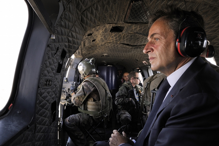<p>France's President Nicolas Sarkozy aboard a helicopter in Kabul, Afghanistan, on July 12, 2011, during a surprise visit to meet troops stationed in Sarobi district.</p>