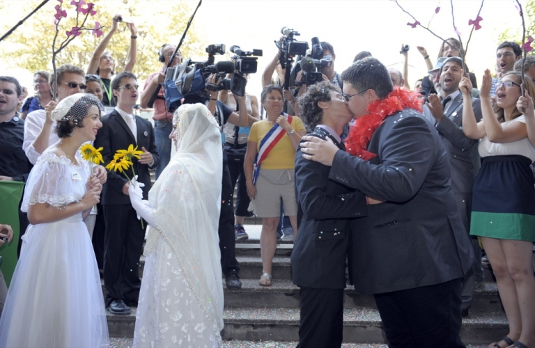 <p>Gays and lesbians take part in a fake gay wedding celebrated by Green party Europe-Ecologie-Les Verts (EELV) activists on the second day of EELV's summer party conference, on Aug. 19, 2011, in Clermont-Ferrand.</p>