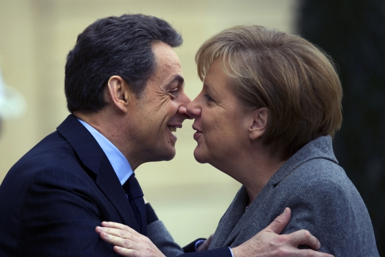 <p>French President Nicolas Sarkozy (L) kisses German Chancellor Angela Merkel upon her arrival for a joint Franco-German cabinet session at the Elysee Palace on Feb. 6, 2012 in Paris.</p>